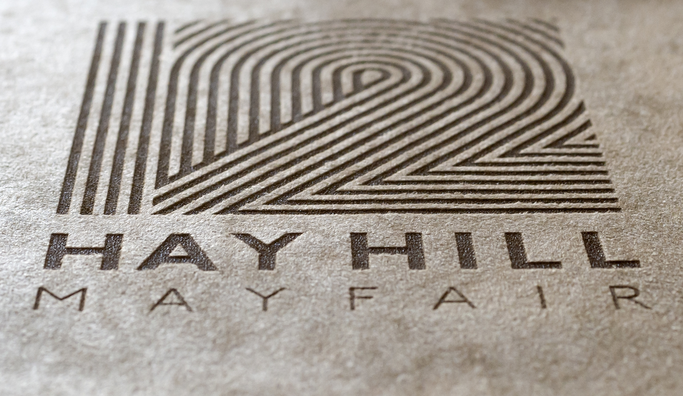 Laser engraved logo on a flip chart cover for 12 Hay Hill, Mayfair.