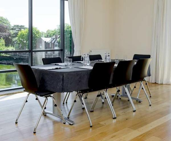 Black conference room table cover at knee height