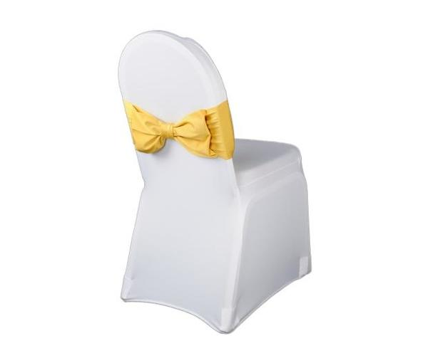 White wedding chair cover with gold bow